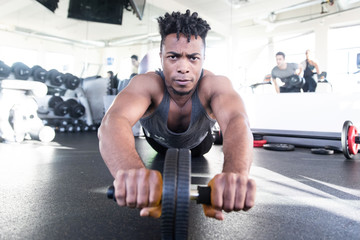 Healthy African American Man working on core strength in gym