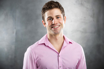Happy man wearing a pink shirt