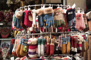 Colorful wool mittens on sale on display