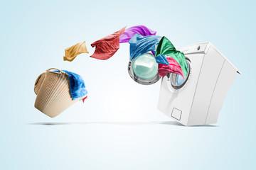 Clothing from laundry basket go into the washing machine