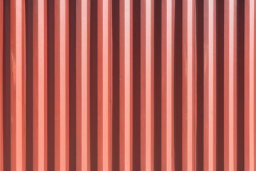 Conten steel container's red side panel abstract row background beautiful shade light shadow.