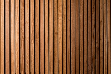 Background of interior vertical timber panelling with subtle fall off of light and focus to the right, suitable for backdrop for corporate portraits in business environment