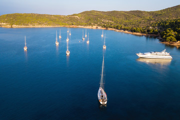 Aerial view of yachts and sailing boats at the marina of Spetses island, Aegean sea, Greece.