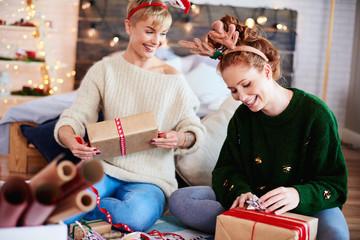Young women preparing christmas gifts