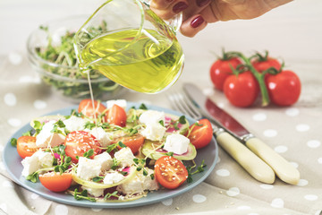 Healthy delicious tasty salad dressed with olive oil