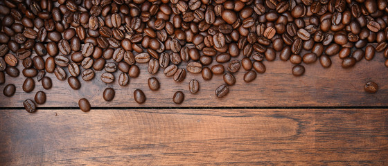 Close up of coffee beans on wooden background