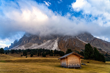 Wooden rural farmer's shed (hut) in a mountains.