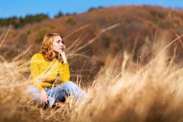 Fashionable girl outdoors enjoying a sunny day