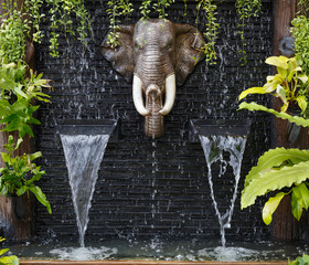 elephant shaped small waterfall in thailand