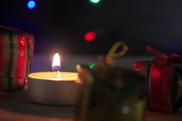 Group of gift box with candle in christmas night concept.