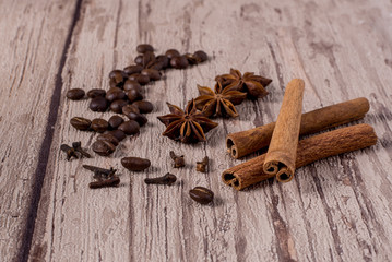 Spices and coffee beans on wooden table.