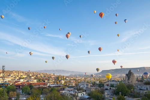 Wall mural Cappadocia cityscape skyline with hot air balloon in Cappadocia, turkey
