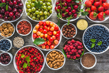 Organic food selection. Fruit, fresh berries and nuts. Healthy superfood assortment.