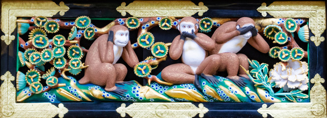 Three wise monkeys at the Tosho-gu shrine in Nikko, Japan, Close up shot