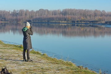 girl taking pictures of beautiful nature