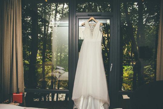 Chiffon bridal dress hanging outdoors