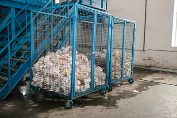 Storage of sorted waste at a waste processing plant for further processing and disposal. Plastic trash.