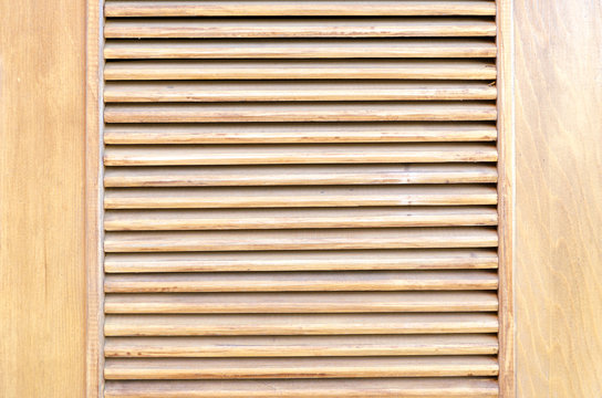 Parallel wooden slats texture. Wooden blinds, as an element of decor. Interior ventilation.  Wood background, close up.