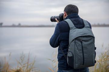 Photographer hand camera