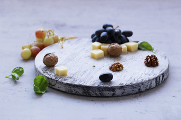 cheese board soft cheese, nuts and grapes
