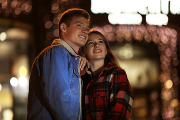 Loving young couple on romantic date in evening