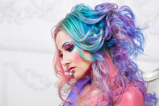 Beautiful woman with bright hair. Bright hair color