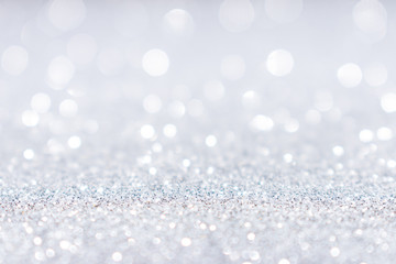 Abstract white silver glitter sparkle background.