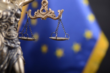Scales of Justice, Justitia, Lady Justice in front of the European Union flag in the background. Wall mural