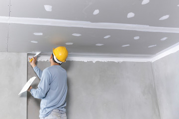 Craftsman working with plaster gypsum ceiling for interior build gypsum board ceiling Wall mural