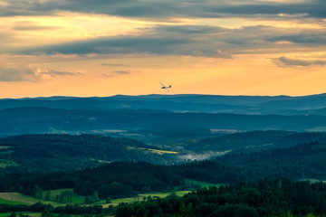 Glider flying over mountains in Bezmiechowa Gorna, Poland. 29-07-2016