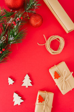 Some christmas presents in decorative boxes on a red background