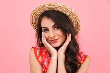 Happy excited young woman posing isolated over pink background wall.
