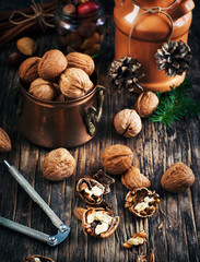 Walnuts on the wooden table. Christmas time