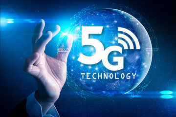 The abstract image of businessman hold the 5G hologram on his hand and element of this image furnished by Nasa. the concept of 5G, communication, network, connection, internet of things.