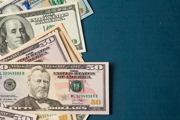US dollar notes on a blue background