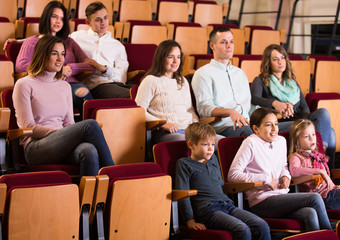 A group of people attentively watching a movie