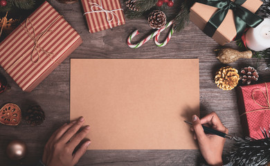 Christmas holiday greeting paper design mockup with decoration on wood table.
