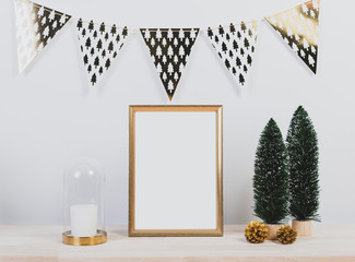 Christmas holiday greeting frame design mockup with decoration on wood table.
