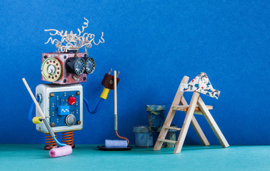 Funny robotic painter decorator ready for interior maintenance. Wooden ladder, paint roller and buckets against blue colored wall.