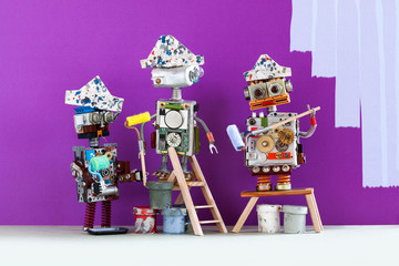 Professional painter decorators team at work. Funny robots with paint rollers and buckets, purple colored room redecoration.