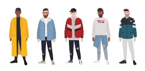 Wall Mural - Collection of young men dressed in fashionable clothes isolated on white background. Set of guys wearing trendy apparel. Bundle of street style outfits. Flat cartoon colored vector illustration.