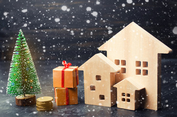 Wooden houses and Christmas tree. Christmas Sale of Real Estate. New Year discounts for buying house. Purchase apartments at a low price. Winter resort and vacation. Holiday discounts.