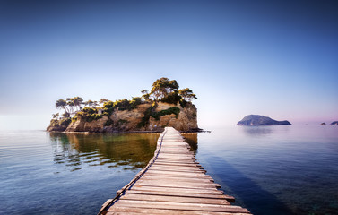 Picturesque view on lonely island Cameo in Greece, part of island Zakinthos or Zante, Port Sostis. Dramatic scenery of solitude island in ocean with wooden path. Iconic landmark on Zakinthos island. Wall mural