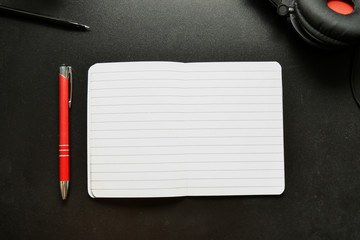 Empty blank notebook on black table, music, inspiration