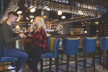 Couple having drinks at bar counter
