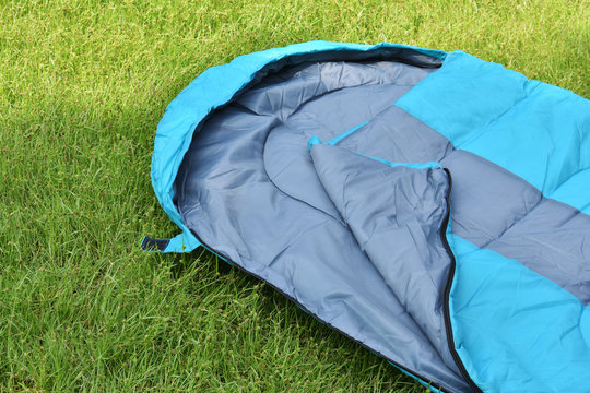 Sleeping bag unzip and closeup inner polyester.