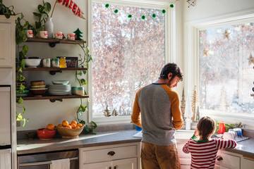 Father and son standing in kitchen