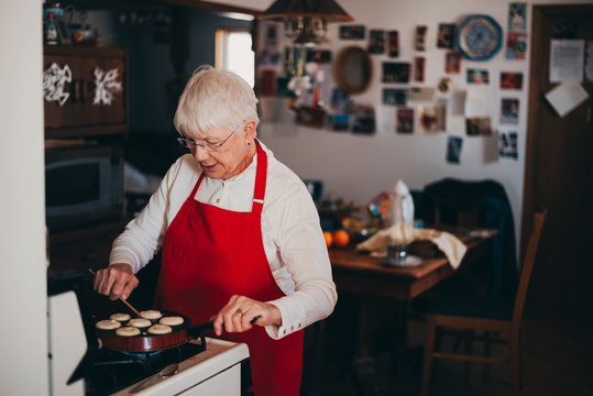 Senior woman cooking traditional Swedish Christmas dumplings