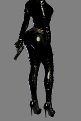 Sexy female assassin in glossy latex suit