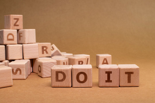 DO IT text made with wooden blocks